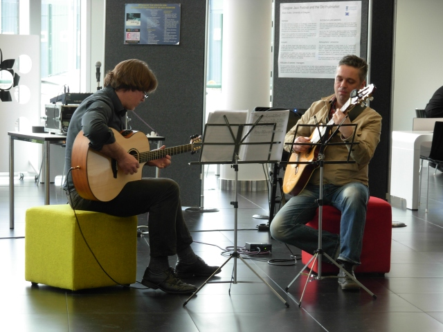 Alan Williams and Haftor Medbøe performing in the lobby at the end of Friday's sessions.